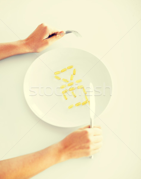 woman with plate and meds Stock photo © dolgachov