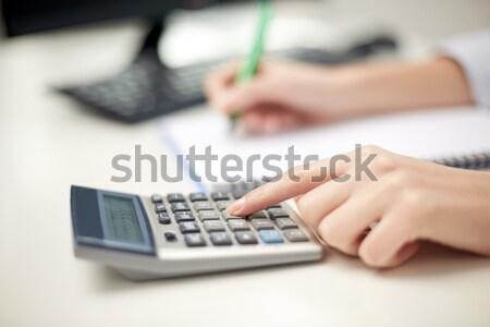 ストックフォト: 女性 · 電卓 · メモを取る · 経済