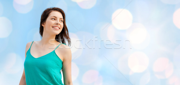 happy girl or young woman looking aside Stock photo © dolgachov
