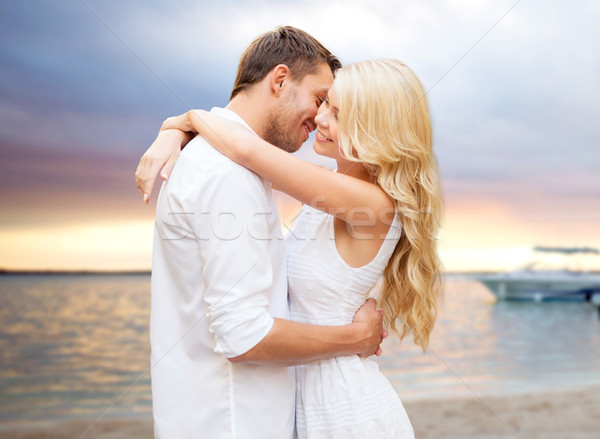 happy couple hugging over sunset at summer beach Stock photo © dolgachov