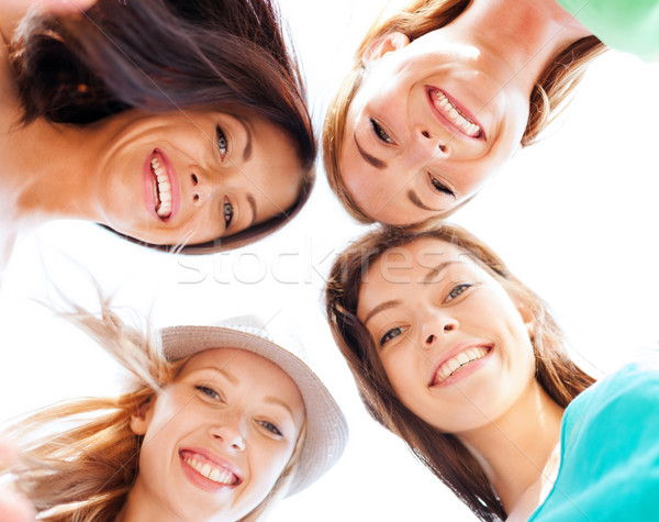 faces of girls looking down and smiling Stock photo © dolgachov