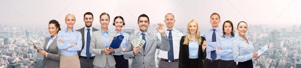 Csoport boldog üzletemberek dollár pénz üzletemberek Stock fotó © dolgachov