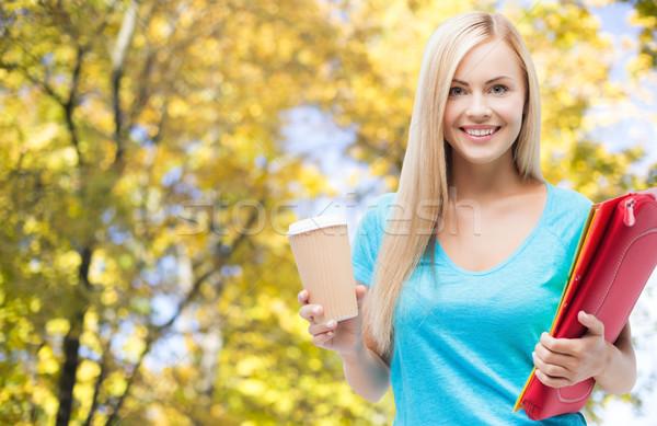 Souriant étudiant fille dossiers tasse de café éducation Photo stock © dolgachov