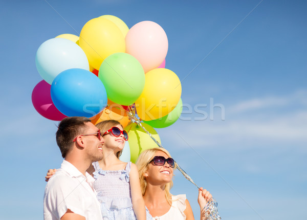 Stock photo: happy family with colorful balloons outdoors