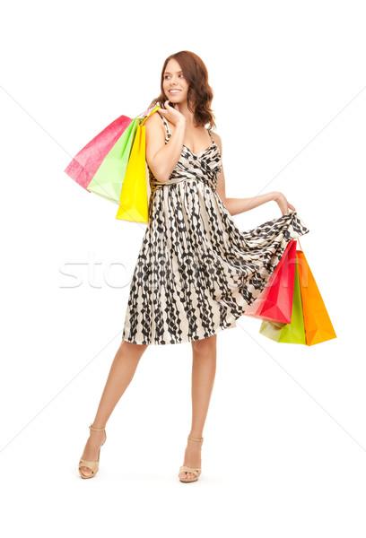 Vásárló nő bevásárlótáskák fehér boldog vásárlás Stock fotó © dolgachov
