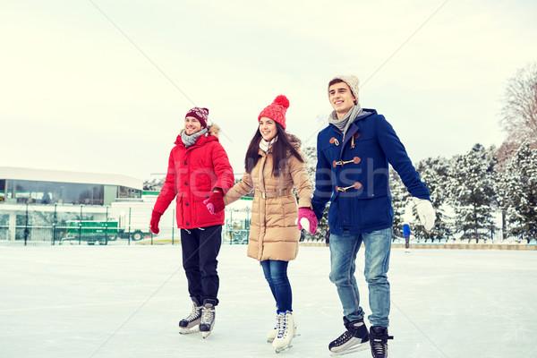 Сток-фото: счастливым · друзей · катание · на · коньках · улице · люди