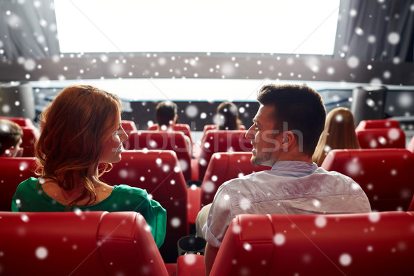 happy friends or couple watching movie in theater Stock photo © dolgachov