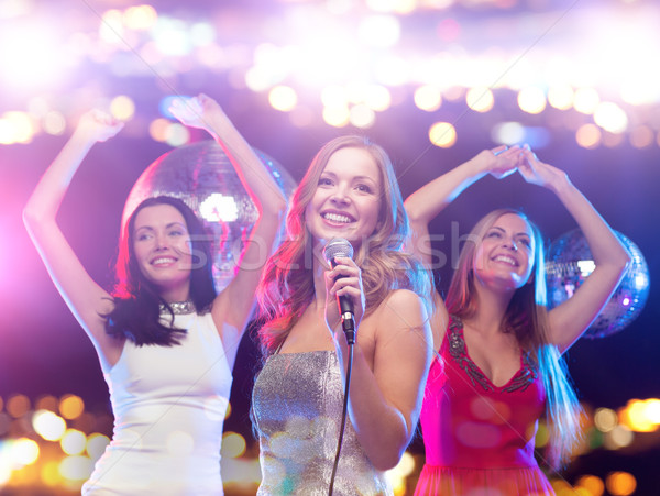 happy women singing karaoke and dancing Stock photo © dolgachov