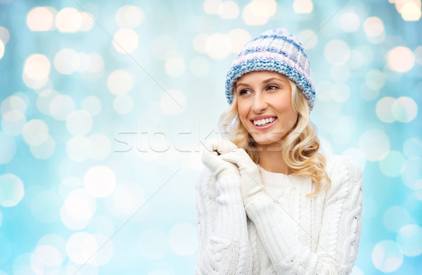 smiling young woman in winter hat and sweater Stock photo © dolgachov
