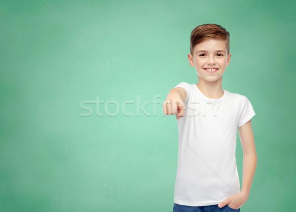 Blanche tshirt pointant doigt enfance Photo stock © dolgachov