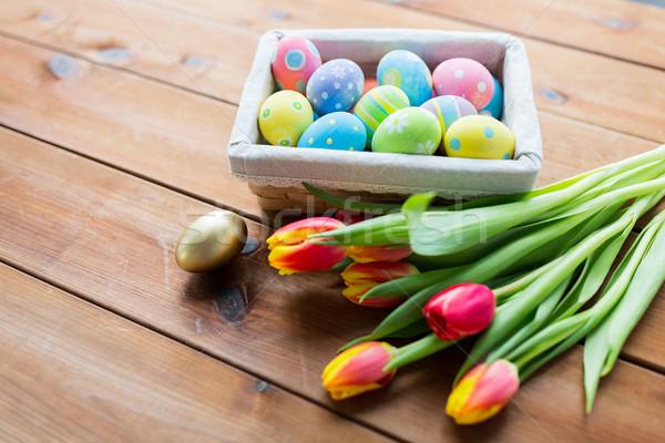 Közelkép színes húsvéti tojások virágok húsvét ünnepek Stock fotó © dolgachov