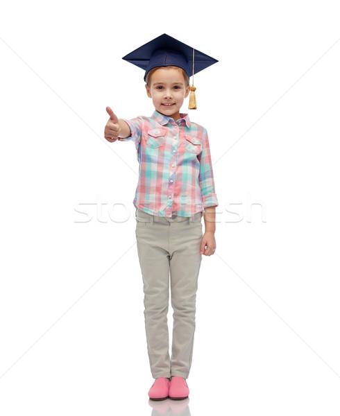 Mutlu kız bekâr şapka çocukluk Stok fotoğraf © dolgachov