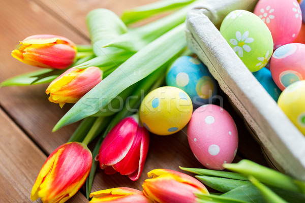 close up of colored easter eggs and flowers Stock photo © dolgachov