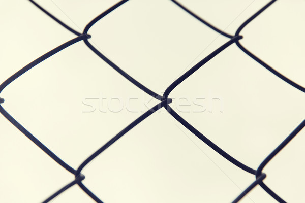 close up of mesh fence over gray sky Stock photo © dolgachov