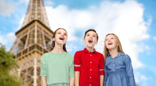 amazed children looking up over eiffel tower Stock photo © dolgachov