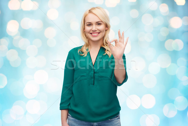 улыбаясь рубашку вызывать рукой знак Сток-фото © dolgachov