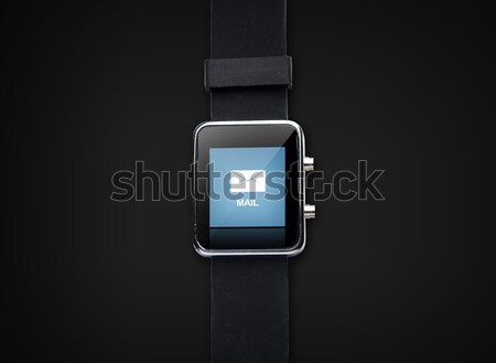 close up of smart watch with e-mail message icon Stock photo © dolgachov