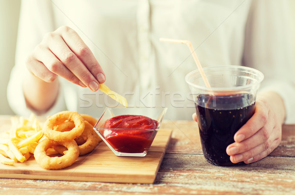 close up of woman with snacks and cocacola Stock photo © dolgachov