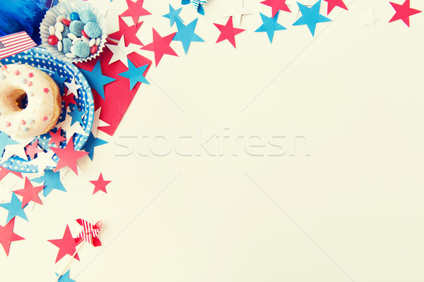donut with candies and stars on independence day Stock photo © dolgachov