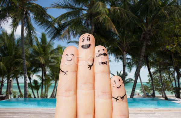 close up of fingers with smiley faces on beach Stock photo © dolgachov