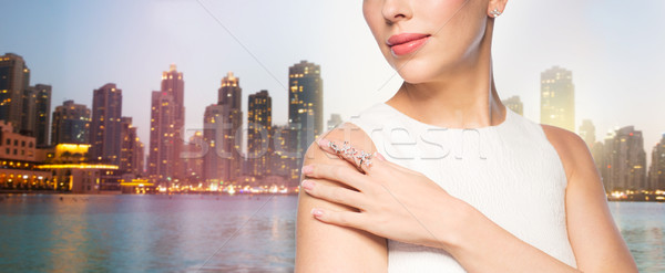 close up of beautiful woman with ring and earring Stock photo © dolgachov