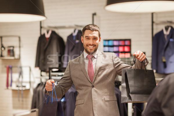 Сток-фото: счастливым · человека · одежду · магазине · продажи