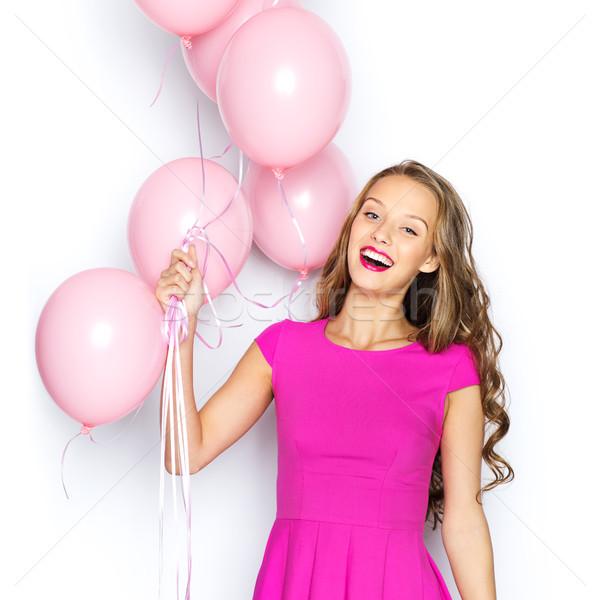 Heureux jeune femme adolescente rose robe beauté Photo stock © dolgachov
