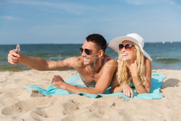 счастливым пару ходьбе лет пляж Сток-фото © dolgachov