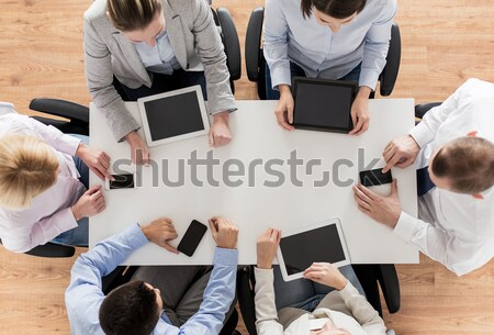 business team with smartphones and tablet pc Stock photo © dolgachov
