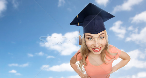 smiling young student woman in mortarboard Stock photo © dolgachov