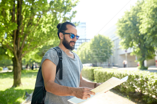 man traveling with backpack and map in city Stock photo © dolgachov