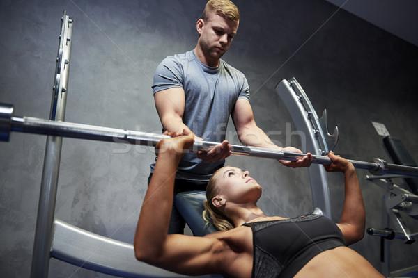 Man vrouw barbell spieren gymnasium sport Stockfoto © dolgachov