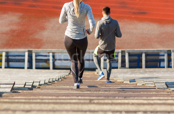 close up of couple running downstairs on stadium Stock photo © dolgachov