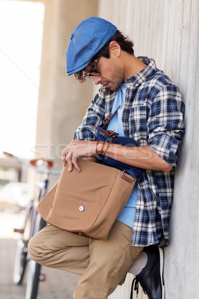 hipster man with shoulder bag and fixed gear bike Stock photo © dolgachov