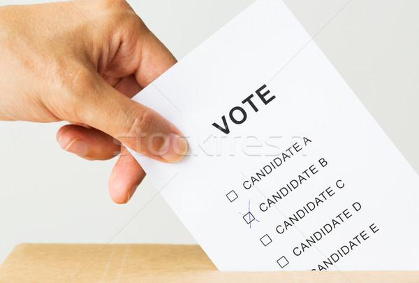 man putting his vote into ballot box on election Stock photo © dolgachov