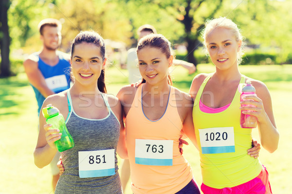 women with racing badge numbers and water bottles Stock photo © dolgachov