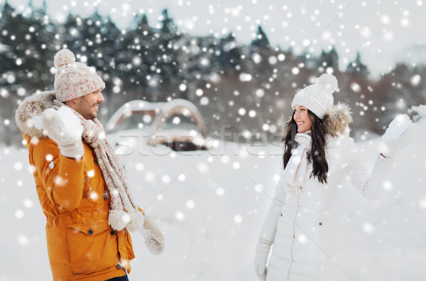 happy couple playing snowballs in winter Stock photo © dolgachov