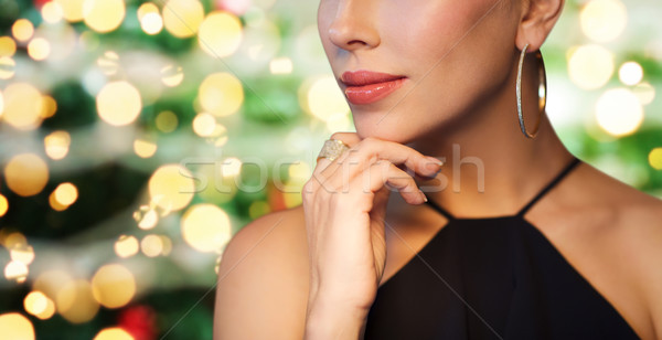 close up of woman in black wearing diamond jewelry Stock photo © dolgachov