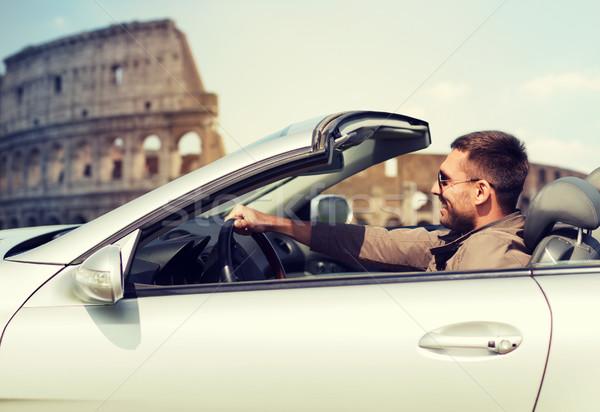 Feliz hombre conducción cabriolé coche viaje Foto stock © dolgachov