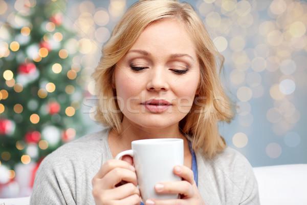 Nő csésze tea kávé karácsony emberek Stock fotó © dolgachov