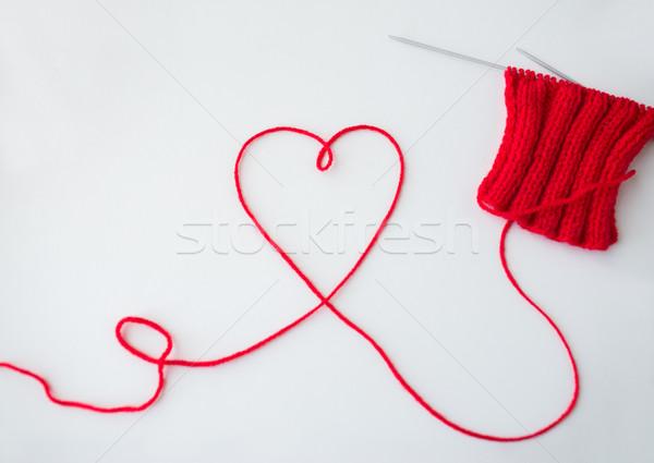 knitting needles and thread in heart shape Stock photo © dolgachov