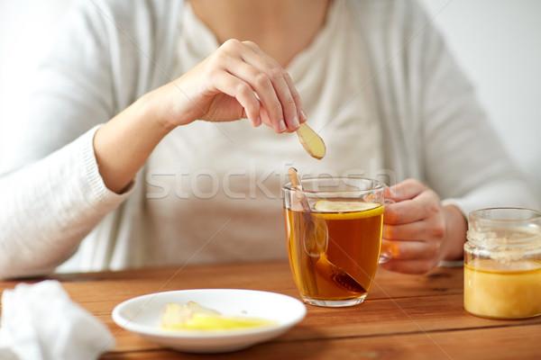 Közelkép beteg nő iszik tea gyömbér Stock fotó © dolgachov