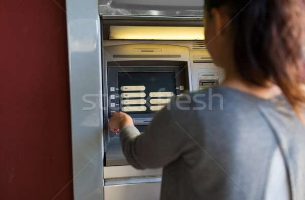 Femme choix atm machine Photo stock © dolgachov