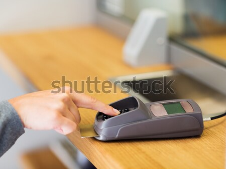 hand entering pin code to card reader terminal Stock photo © dolgachov