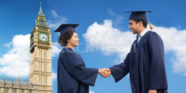 Feliz estudiantes solteros saludo otro educación Foto stock © dolgachov