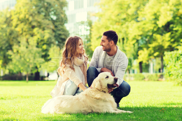 Stock photo: happy couple with labrador dog walking in city