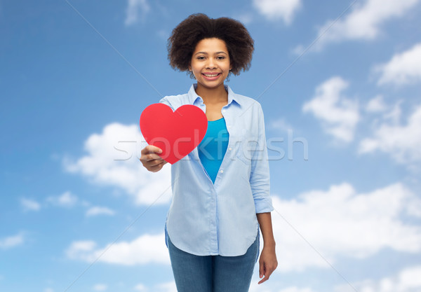happy african american woman with red heart shape Stock photo © dolgachov