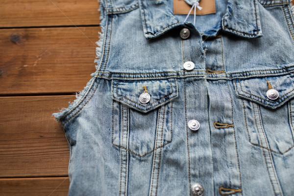 close up of denim vest or waistcoat on wood Stock photo © dolgachov