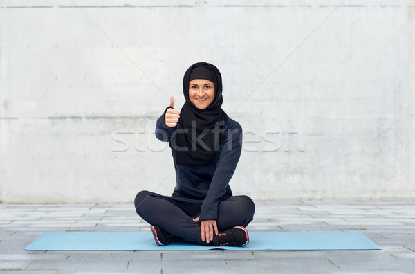 muslim woman doing sport and showing thumbs up Stock photo © dolgachov