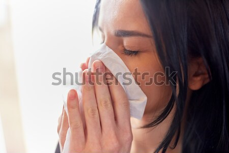 close up of woman with wipe blowing nose or crying Stock photo © dolgachov